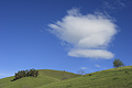 Cloud over green hills near Mount Hamilton, San Jose, California