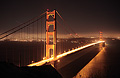 Golden Gate Bridge at night, San Francisco in the background